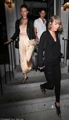Fun group:Just a few days prior she enjoyed a gal-pal dinner date with besties Taylor Swift (right) and Behati Prinsloo