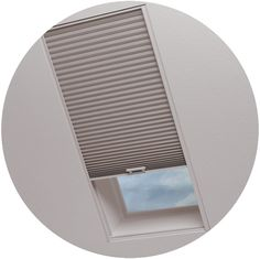 Learn more about Hunter Douglas skylight systems available on our honeycomb shades and vertical blinds. These manual or motorized lifting systems are especially suited for skylights.
