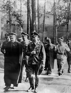 Adolf Hitler with Heinrich Himmler. Hermann Goering and Benito Mussolini are in the background. I believe this was taken on 20 July 1944 at the Wolf's Lair shortly after the failed assassination attempt on Hitler.