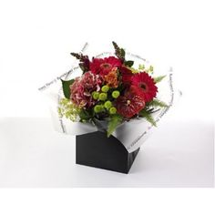 An expertly hand tied aqua packed bouquet of beautiful red roses, green anastasia, kermit santini, red snapdragon, pink hydrangea, pink gerbera, hypericum berries, red anthurium and pink alstromeria, presented in exclusive Bumblebeez wrap and a black gift bag.