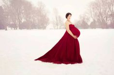 Maternity Photo in the Snow - Gorgeous Contrast with the Red Dress!