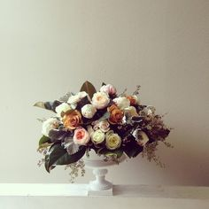 Antique mix of dusty miller, garden roses, and peonies
