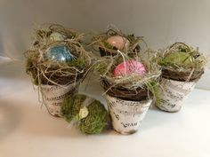 Potted nests,cover peat pots with paper of choice, add nest and a glittered egg