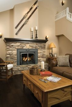 Stacked stone fireplace - shape, raised hearth - not the fire box we are getting--mantel too dark