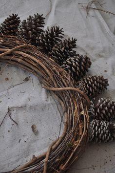 DIY Pine Cone Wreath--Probably cheaper to use a Styrofoam wreath as a base.