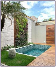 Small backyard pool with wooden decking and grass turf around it to reduce mantainence.The wall is treated with vertical garden, stone and woosen cladding as well. modern Backyard with pool Backyard pool with vertical garden. Small Backyard Design, Small Backyard Pools, Backyard Pool Designs, Modern Backyard, Backyard Patio, Backyard Landscaping, Small Garden With Pool Ideas, Small Inground Pool, Vertical Garden Design