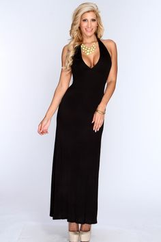 Instantly transform into a Grecian goddess in this floor sweeping showstopper. This maxi dress will give you a shape to show off, while the length gives it a high fashion edge. Featuring V neckline, halter string ties, open back, long length, and finished with a relaxed comfortable fit. 96% rayon 4% spandex.