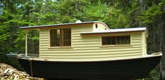 """This is a small houseboat, or """"Shantyboat"""" designed by H. Bryan. Simple accomodations for two, a straight forward galley space with a woodstove, and a back porch for enjoying the sunsets from your chair! This type of boating is overdue for a revival - a trailerable floating cabin. Salt or freshwater, either at anchor, mooring or self propelled."""