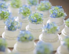Mini Cakes prob won't do the mini thing for cakes but these are so cute!!