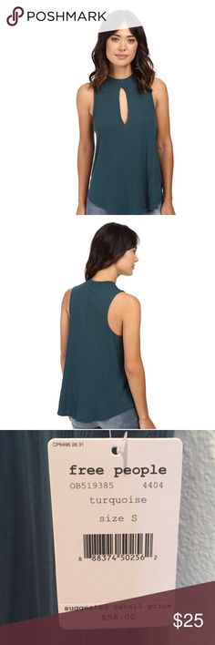 Free People Tank Top Super simple top but sexy with keyhole design!Gently flared tank is fabricated from a slubby, ribbed knit ideal for layering.  Extended keyhole at front lends to flirty style. Color is dark turquoise. Free People Tops Tees - Short Sleeve