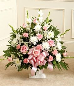 Sympathy floor basket arranged with pink roses, pink carnations and white flowers for funeral delivery. Arrangements Funéraires, Funeral Floral Arrangements, Beautiful Flower Arrangements, Beautiful Flowers, Church Flowers, Funeral Flowers, Flowers For You, White Flowers, Casket Flowers