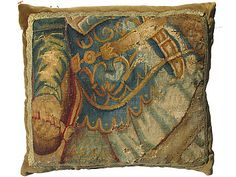 Pillow made from antique tapestry fragment