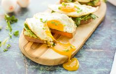 Sweet Potato Toast with Egg is a hearty, wholesome breakfast that will keep you fueled until lunch. The sweet potato toast topped with avocado, greens and sunny side up eggs. #AD #paleo #whole30 #keto #glutenfree #lowcarb