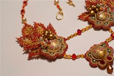 Agates Des.  Red and gold soutache beaded necklace