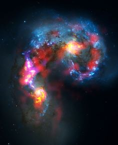 The Antennae Galaxies are a pair of distorted colliding spiral galaxies about 70 million light-years away, in the constellation of Corvus (The Crow). This view combines ALMA observations, made in two different wavelength ranges with visible-light observations from the NASA/ESA Hubble Space Telescope.