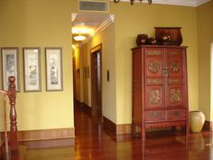The second floor hallway features a beautiful red antique Chinese cabinet that dates back to the Qing Dynasty.
