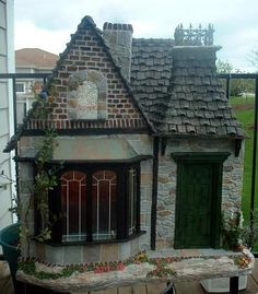 Dollshouse. With the buildings around it I think it's a real 'dollshouse' ?