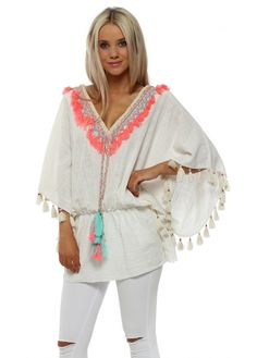 d6680ec75b40 This aqua kaftan top from Laurie & Joe with stunning neon pink tassle  detail is absolutely stunning