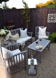 Cozy up an outdoor space with fabulous accessories from HomeGoods. A neutral white and gray space looks great with accessories in both silver and gold. Sponsored Pin.