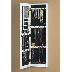 Wall jewelry box, closed it looks like a mirror/picture frame hanging on the wall. BEST idea ever!