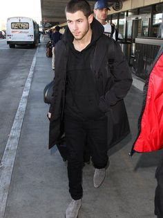 Nick Jonas demonstrates the appeal of gray suede boots.