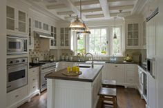 Love the unique ceiling.  The cottage-y meets rustic with the wooden stools, island counter and the bead board.  Mmmmmm.