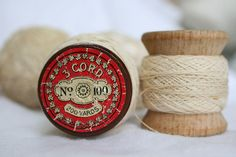 I have a bunch of these spools at home, and welcome suggestions on how to best display them!