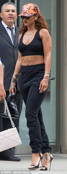 City chic: The Diamonds hitmaker opted for a sporty yet sexy look, teaming her revealing blouse with a pair of high-waisted black tracksuit trousers