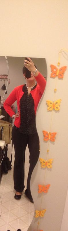 H&M black and white blouse, red sweater, black dress pants , Payless black flats