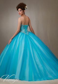 Quinceanera Dress  Vizcaya Morilee 89073 Layered tulle ball gown with embroidery and jeweled beading  Colors: Pink Champagne and Island Blue  A back side view