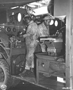 England. Cpl. Carroll B. Johnson, Port Arthur, Texas, and Pfc. Carroll Davis, Philadelphia, Pa., at work in their Mobile Machine Shop as part of the 829th Engineers, near Eye, England. (2 Mar 43) Signal Corps Photo: ETO-HQ-43-1632 (Pearson)