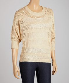 Cozy+up+to+style+in+this+lovely+sweater.+Its+subtle+stripes+and+lightweight+construction+make+it+a+perfect+pick+to+layer+up+on+a+breezy+day.