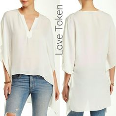 """100% Silk Blouse by Love Token Gorgeous 100% silk ivory blouse by Love Token. Split neck, short sleeves. Hi-lo hem, approx 25"""" shortest length, 33"""" longest length. Semi-sheer. Absolutely stunning when worn. Has a few very small flaws. One run on back at top (not visible unless you're looking for it and falls below medium to long hair). A few pulled threads on right lower middle front (very small and do not stand out). Both pictured, with my fingernail for size. Bundle 2 + items and save 10 %…"""