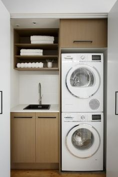 Laundry in a cupboard might fit inthe space yu have. Only a small sink but could work
