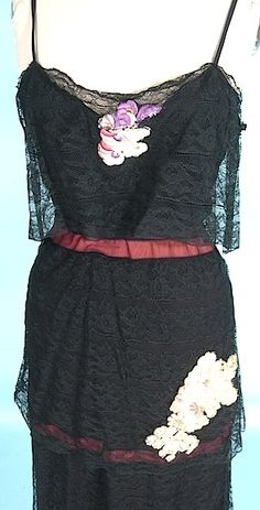 "c. 1930's Black Net with Floral Appliques 3-piece Outfit! Hooded Coat, Camisole and Skirt. The material and the appliques at certainly from the 1930's... even the black lace on the inner balloon sleeves and the coat hood are 1930s. However you would expect to see a gown under this hooded coat, but instead it's a 2-piece ""dress""... with camisole top (with scalloped hemline of silk) and an ""elastic"" waist tiered lace skirt. Detail dress"