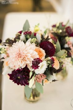 old and purple wedding flowers and decor
