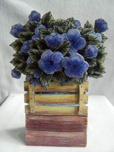 Blue pansies in a wooden crate greeting card.