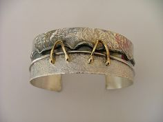 Cuff |  Donna Stiles.  Solid silver & 18K gold bracelet