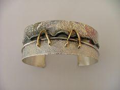 Cuff    Donna Stiles.  Solid silver & 18K gold bracelet