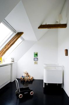 would never have thought of black in a nursery, but the black floors seem like the perfect complement to the white walls and exposed wood beams in this case (via remodelista)