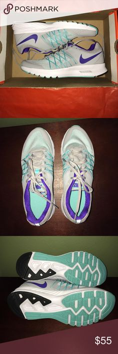 Grey, Teal and Purple Nike Air Gorgeous tennis shoes! Were gifted to me but not exactly my style! Brand new in box :) super cute colors and VERY COMFORTABLE! Nike Shoes Sneakers