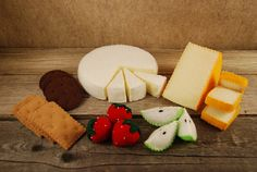 Hey, I found this really awesome Etsy listing at http://www.etsy.com/listing/37732044/felt-food-brie-crackers-and-fruit-set