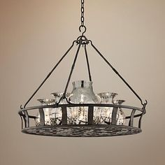 Intriguing and interesting, this chandelier features antique silver vases suspended within a Chianti bronze finish basket.