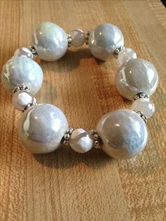 Sparkling white stretch bracelet. Chunky ceramic beads surrounded by silver plated spacers and white patterned Agate. Very classy and unique!!