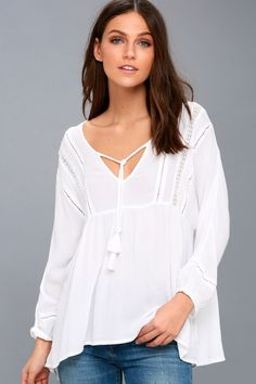 Feel like you're on vacay, even if your just running errands, in the Amuse Society Cool Breeze White Long Sleeve Top! Breezy, gauzy fabric falls from a V-neck (with tasseled ties), into a breezy, wide-cut bodice and long sleeves with elasticized cuffs. Pierced crochet detail adds a Boho touch to bodice and sleeves.