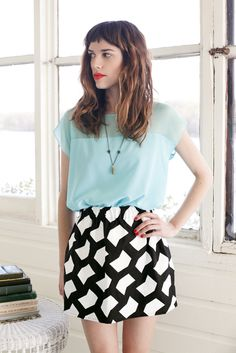 mint top + graphic print skirt.