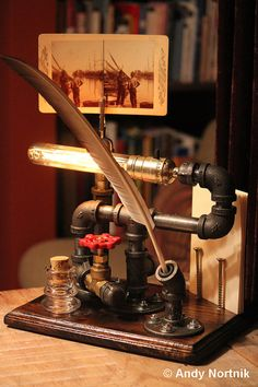 Steampunk Calligraphy set by Steampunk Artist Andy Nortnik. Complete with handmade feather quill, ink well, vintage Stereoscope card holder and Edison style filament tube bulb. © Andy Nortnik https://www.etsy.com/listing/182171140/desk-set-calligraphy-calligrapher?