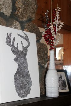 Easy DIY Christmas decor - create a chic and sparkly reindeer silhouette with a canvas, come glue, and some glitter!