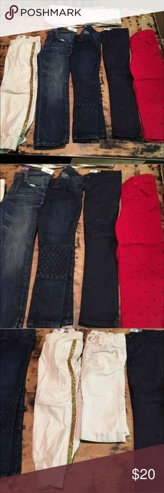 6 pair of pants 5T 6 pair of pants all size 5T one is NWT the other we're only wore one time my baby is kinda chunky and can't wear nothing but leggings the skinny pants next to the red ones has a small stain it looks like nail polish but u can't really see it Bottoms Jeans