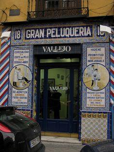 Traditional barber shop with tile work facade. Calle de Santa Isabel, Madrid,Spain